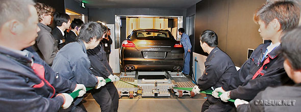 A Porsche Panamera on its way to the 94th floor of the World Financial Centre in Shanghai