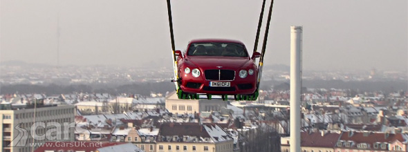 Bentley Continental V8 flying across Munich beneath a Helicopter