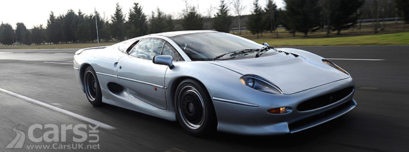 Silver Jaguar XJ220 on track