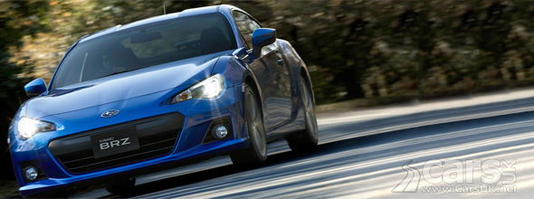 Blue Subaru BRZ on road