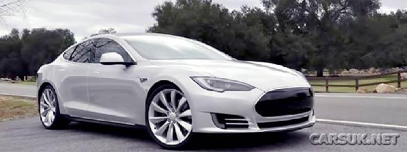 Photo of black Tesla Model S on road