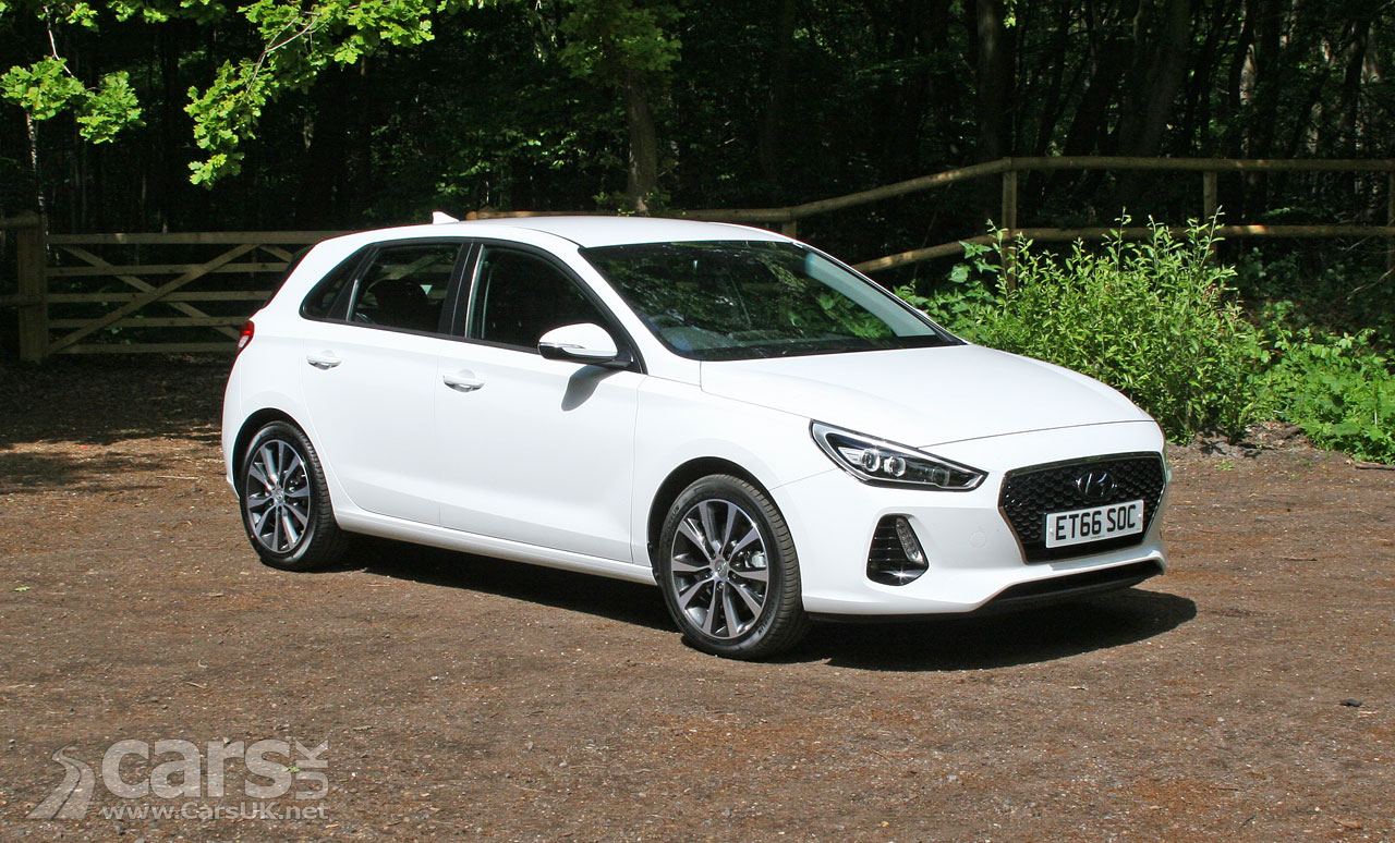 Photo of a white 2017 Hyundai i30 1.4 T-GDi SE Nav in for review at Cars UK