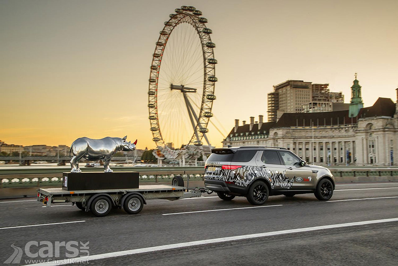 A Land Rover Discovery tows Gerry McGovern's Chrome Rhino over Westminster Bridge.