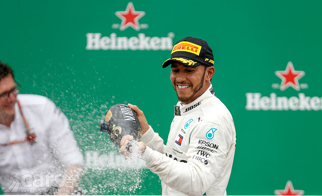 Lewis Hamilton celebrates winning the 2018 Brazilian Grand Prix