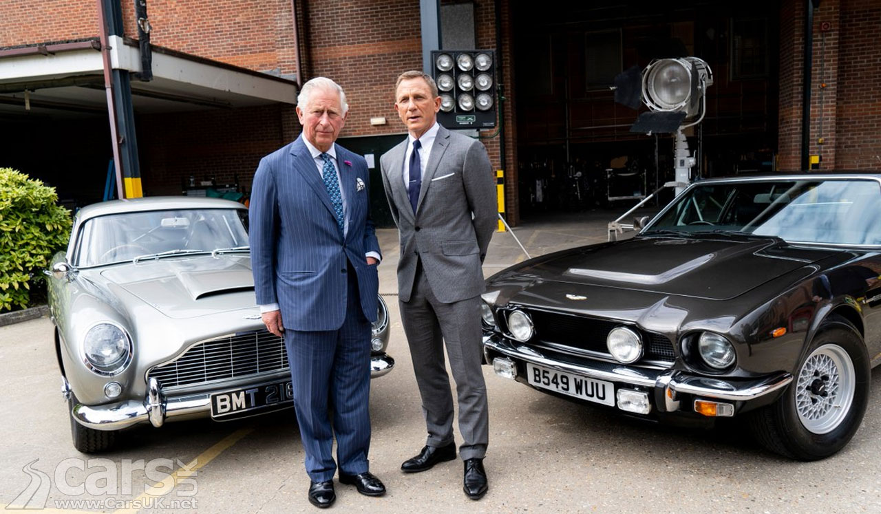 Prince Charles and Daniel Craig with the Bond Aston Martin DB5 and Aston Martin V8